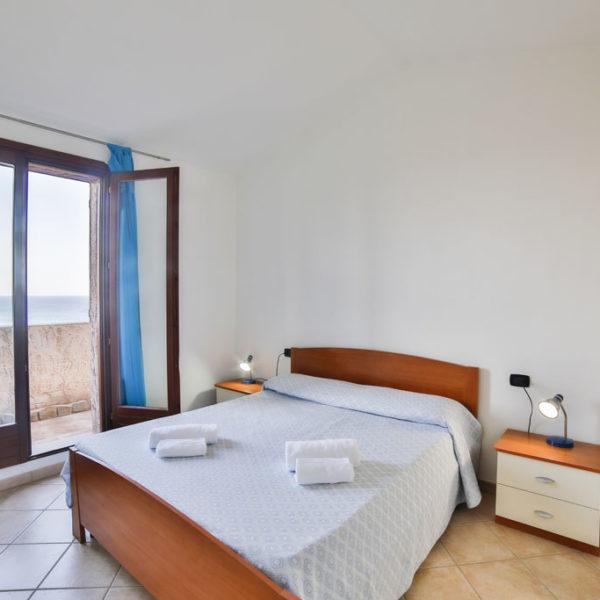 camera letto matrimoniale ville resort corallo vacanze