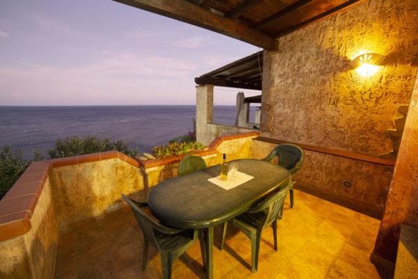 porto corallo: quadrilocale con veranda con vista mare corallo vacanze